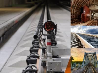 Geodetic survey support of track superstructure arrangement.